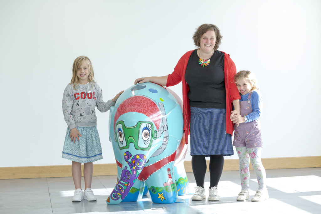 Artist Bethan Laker with her daughters Charlotte (9) and Georgie (6) attend the Elmer's Read North Parade preview event at Quorum Business Park in Newcastle Picture: DAVID WOOD